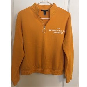 Orange 3/4 zip up sweater.